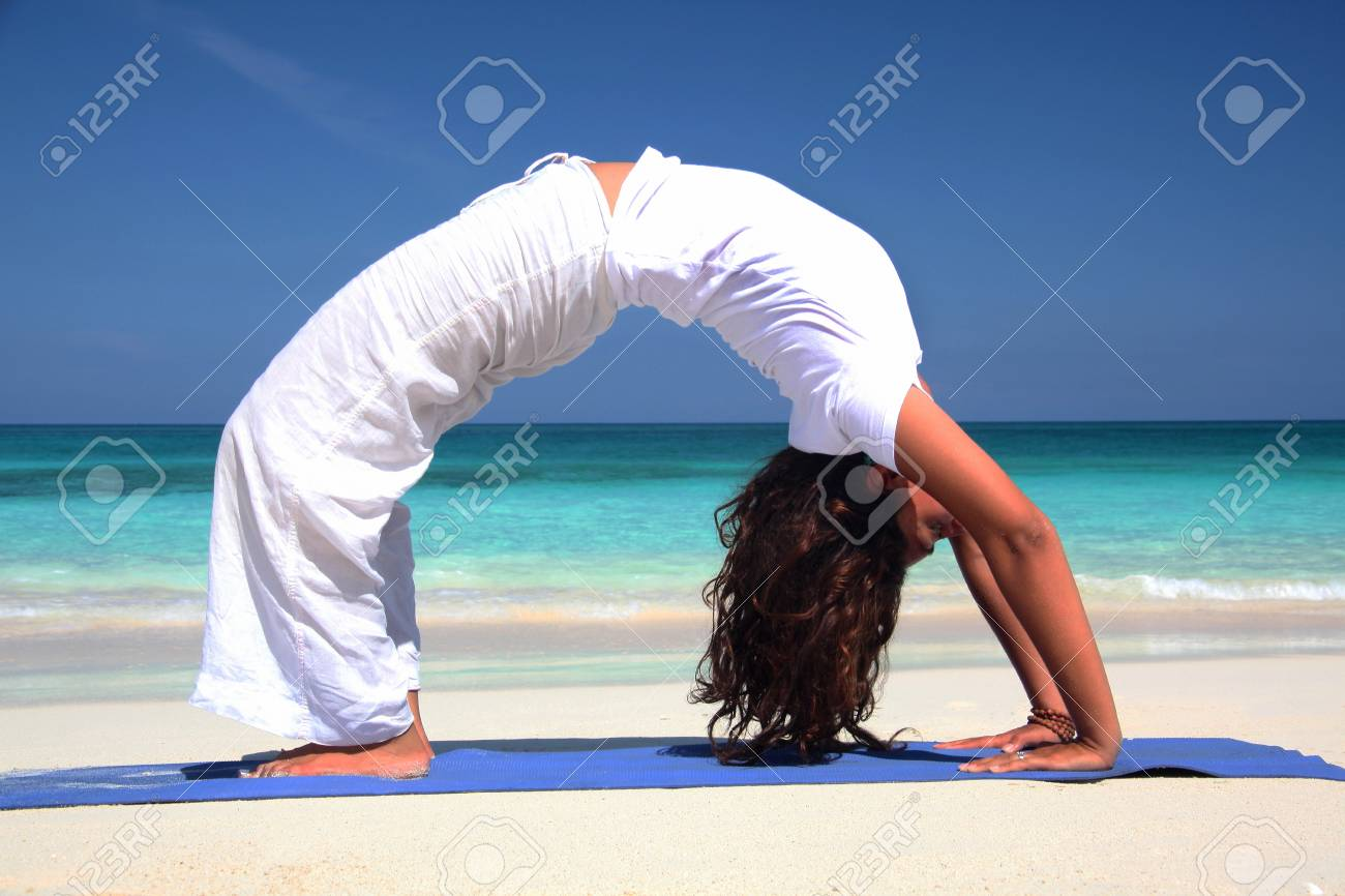 Young Woman Practicing Yoga On Beach Paradise Island Nassau Stock Photo Picture And Royalty Free Image Image 118080359