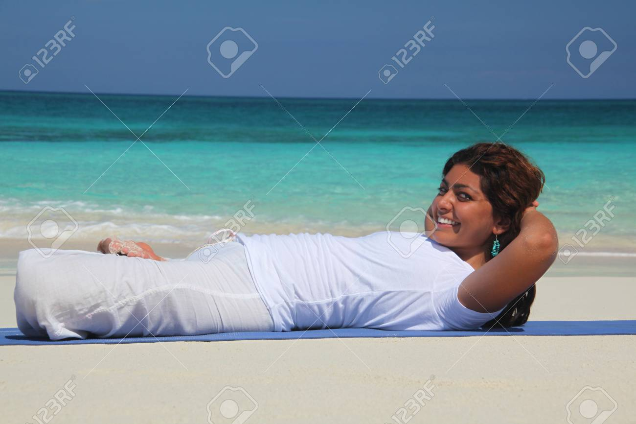 Young Woman On Beach Practicing Yoga Paradise Island Nassau Stock Photo Picture And Royalty Free Image Image 118202919