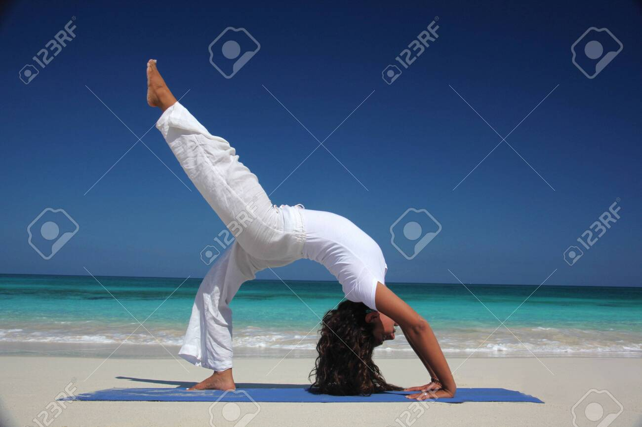 Young Woman Doing Yoga On Beach Paradise Island Nassau Bahamas Stock Photo Picture And Royalty Free Image Image 118203596
