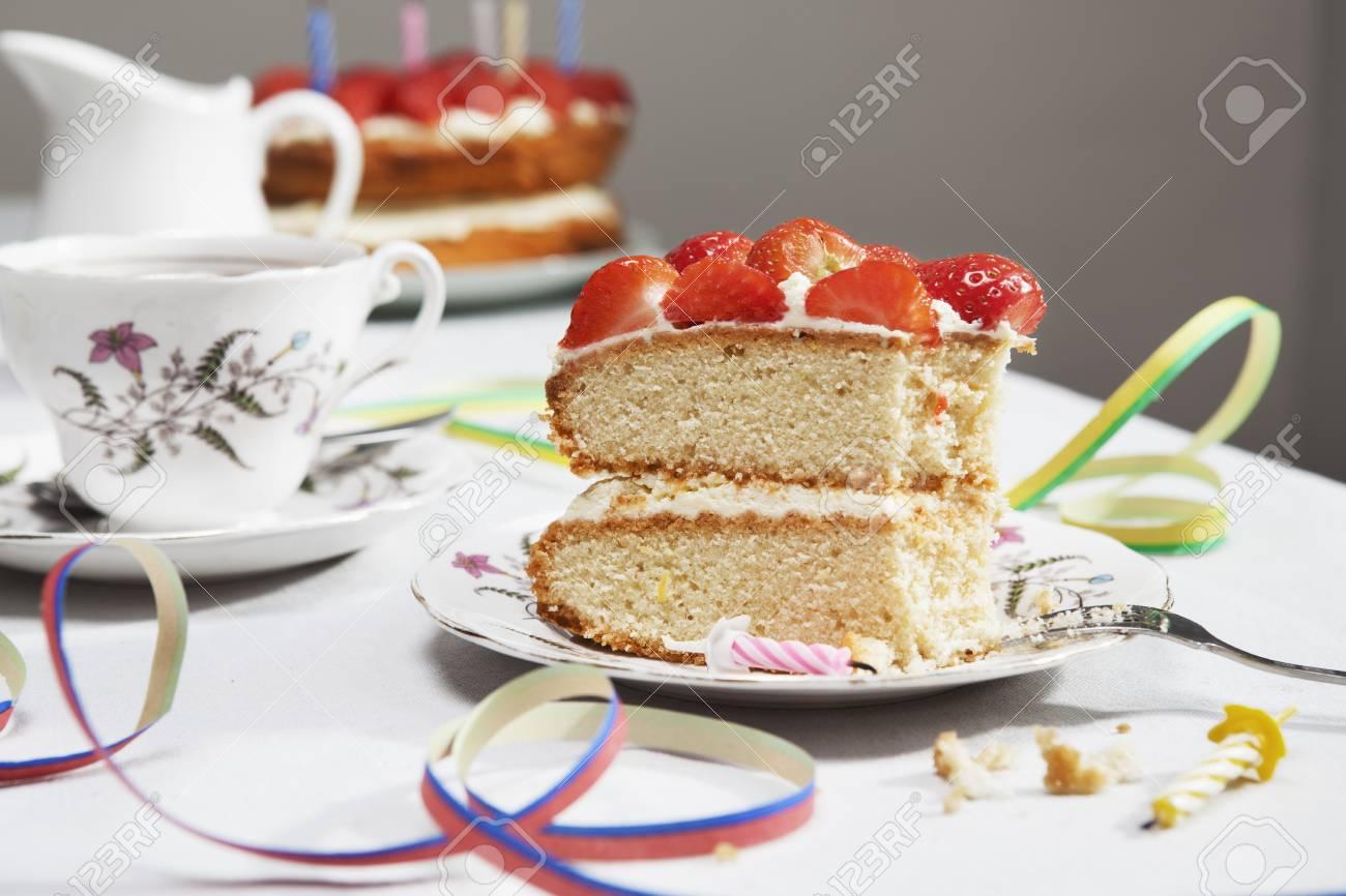 Slice Of Birthday Cake With Tea Stock Photo