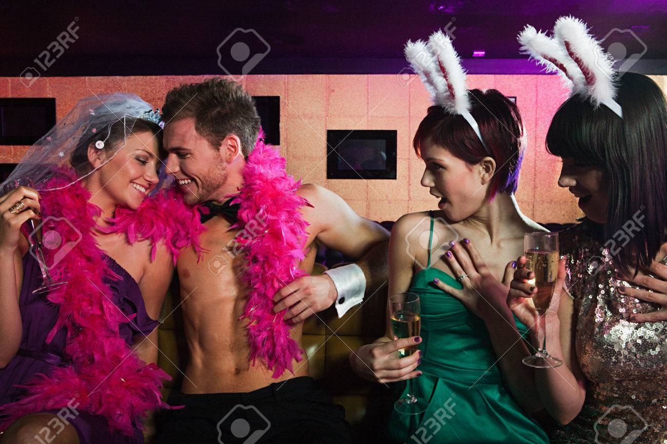 Stock Photo - Young women on hen night with male stripper