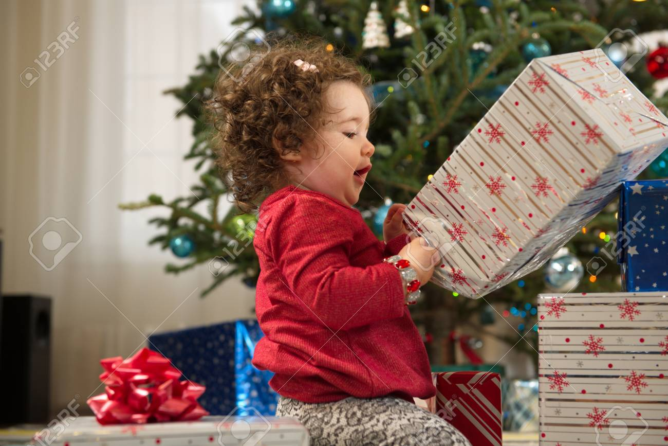 Toddler Girl Opening Christmas Gifts Stock Photo, Picture And ...