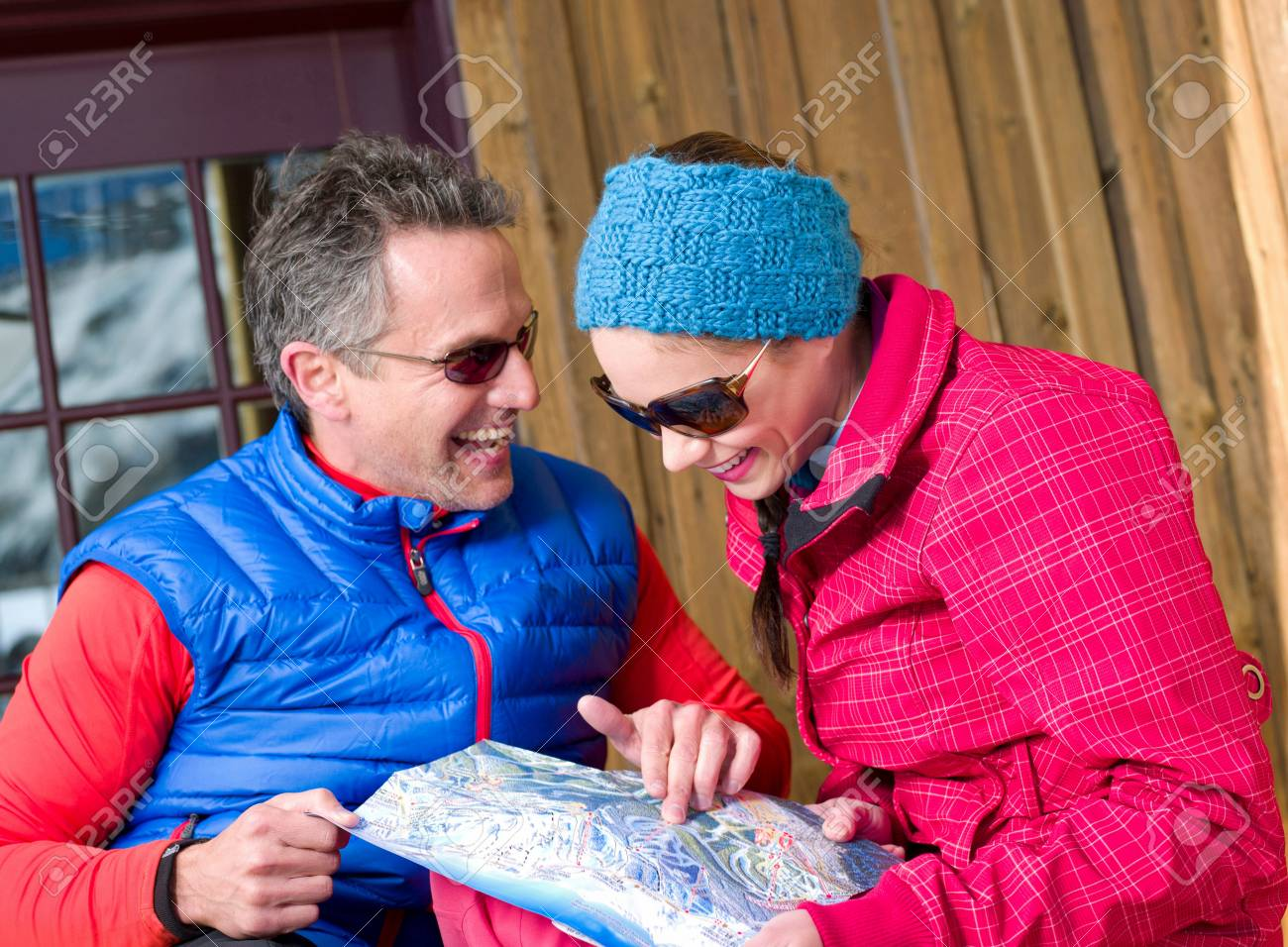 Mature man and young woman looking at map in ski resort Stock Photo -  81323172