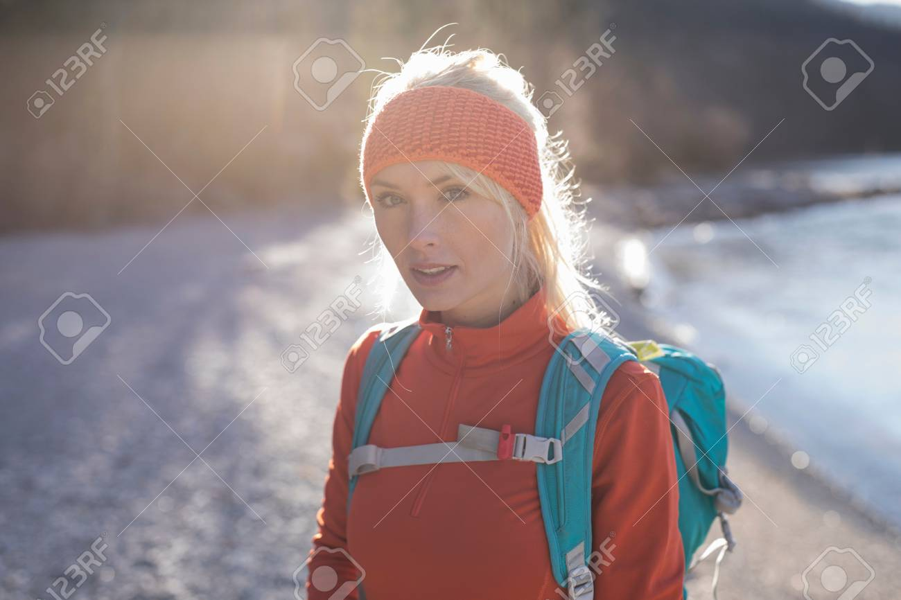 0b29f3fb2 Backlit Portrait Of Young Female Hiker On Lakeside In Bavarian ...