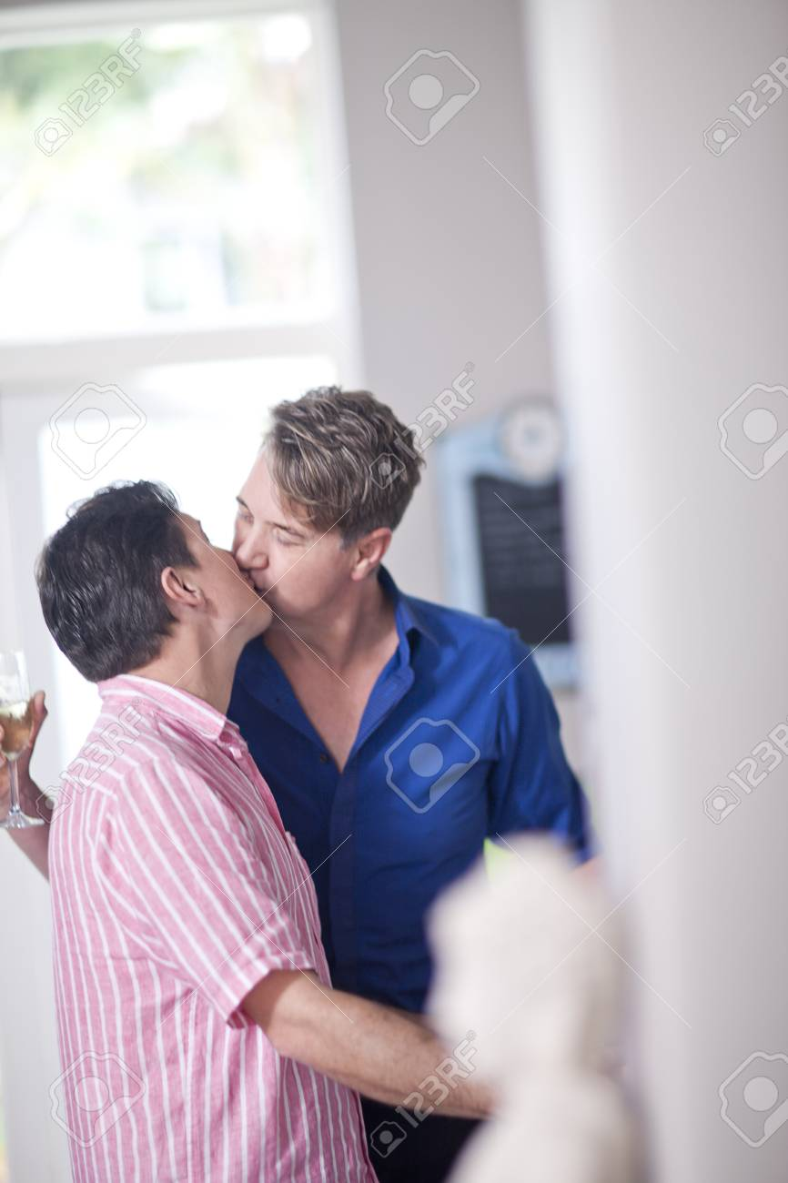 mature homosexual couple kissing stock photo, picture and royalty