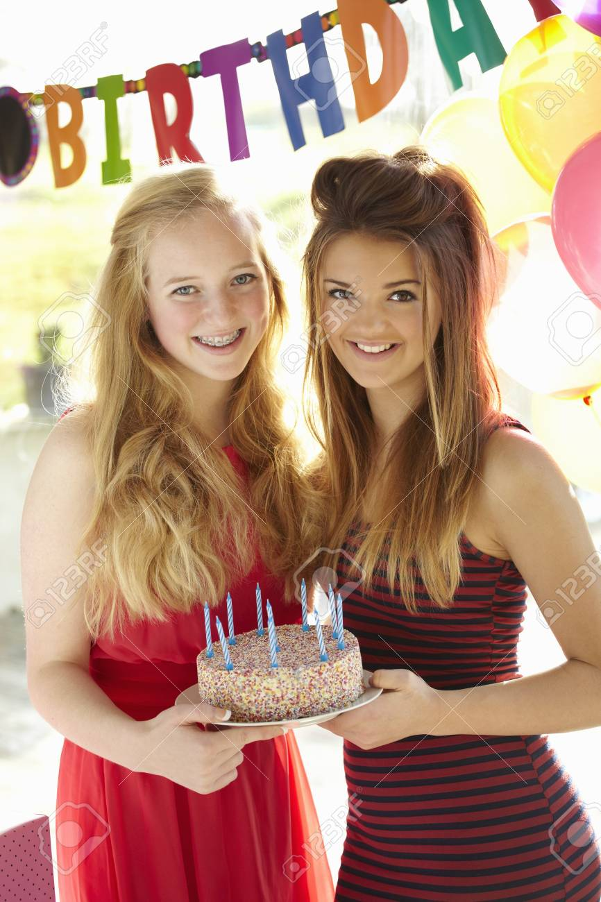 Tremendous Two Teenage Girls Holding Birthday Cake Stock Photo Picture And Birthday Cards Printable Opercafe Filternl