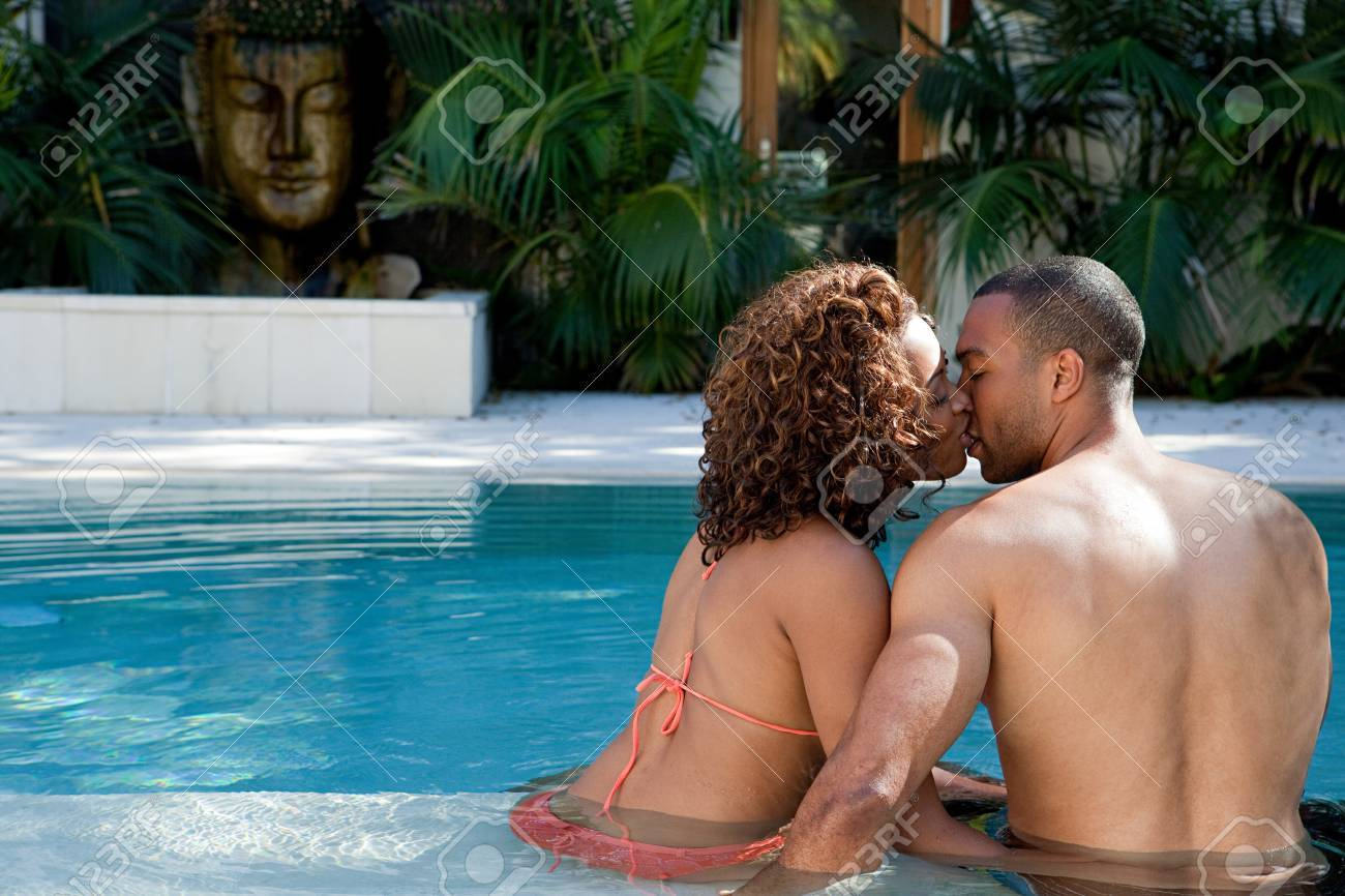 People kissing in a pool