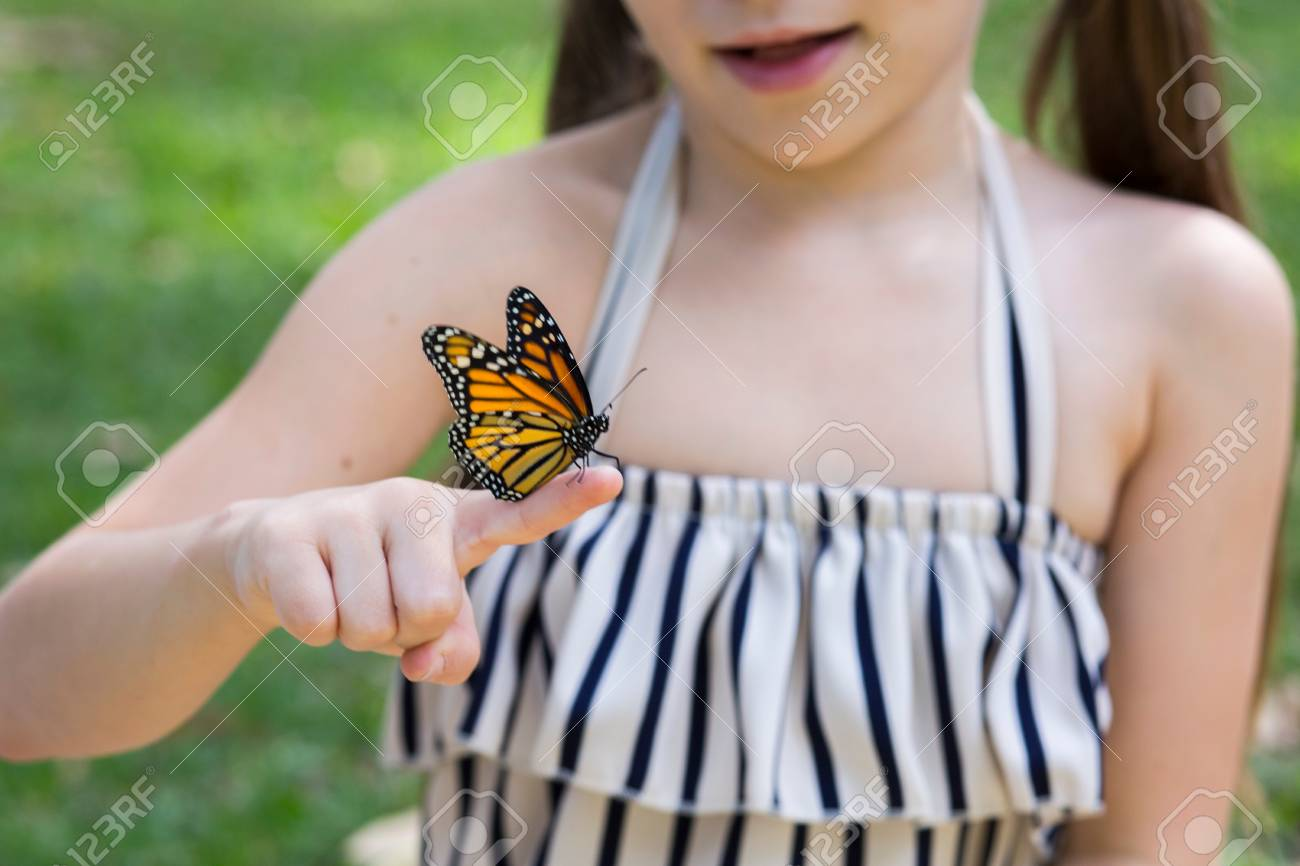 f26d60675 Girl Holding Monarch Butterfly On Finger Stock Photo, Picture And ...