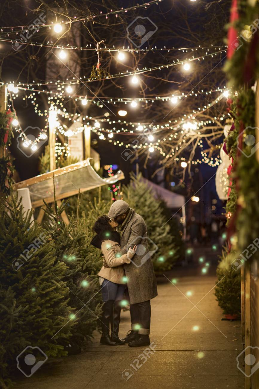 Romantic Couple Kissing In Christmas Market At Night, New York ...
