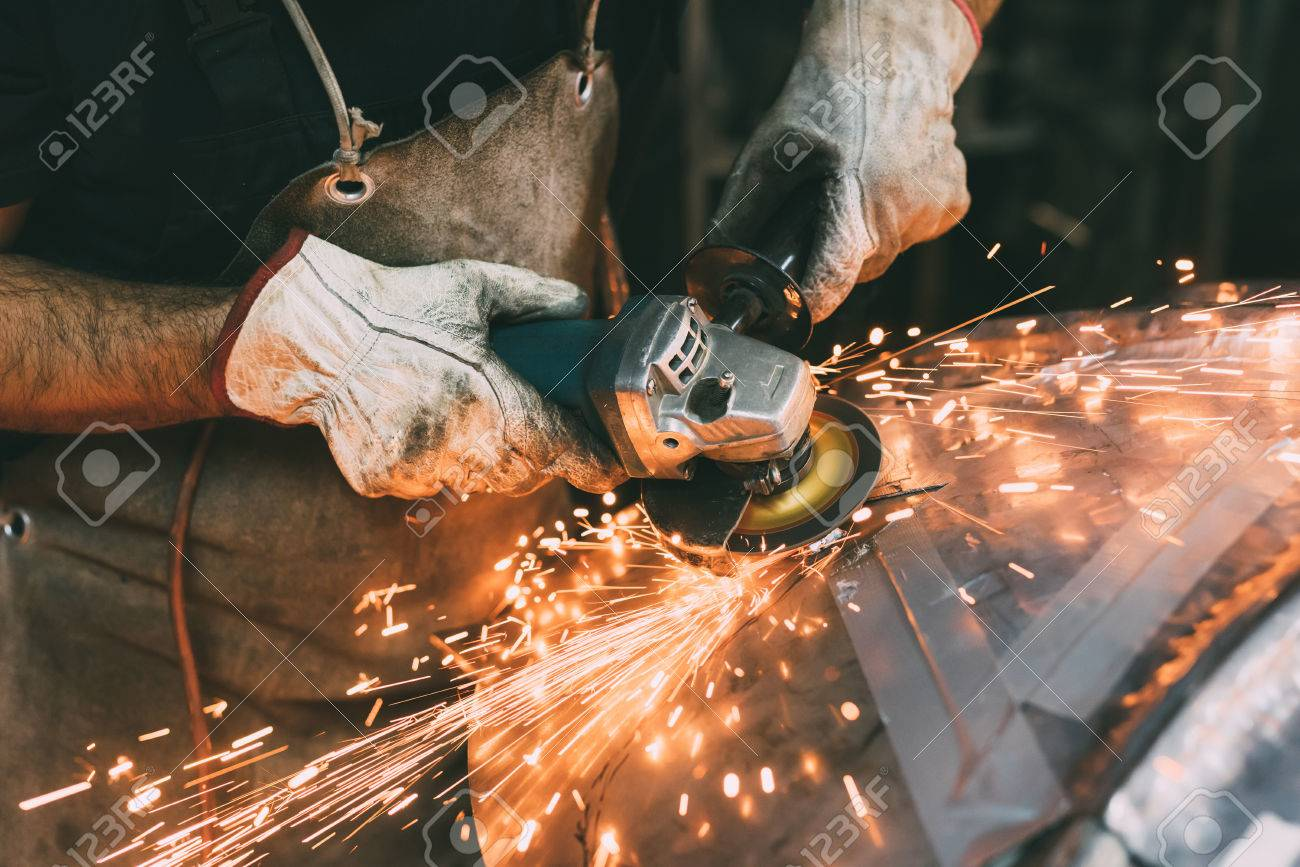 Hands of metalworker grinding copper in forge workshop Stock Photo - 87366874