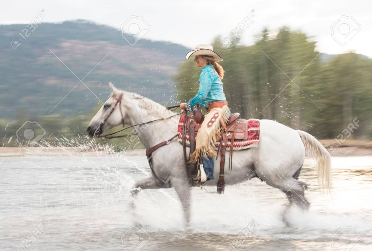 mature woman riding horse, missoula, montana, usa stock photo