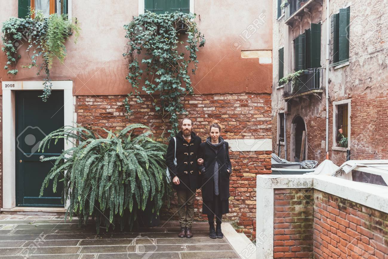 Portrait Of Couple In Courtyard Venice Italy Stock Photo