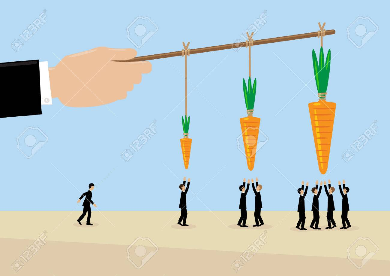 A large hand holds a carrots on a stick. A metaphor on management, incentive and leadership. - 57552419