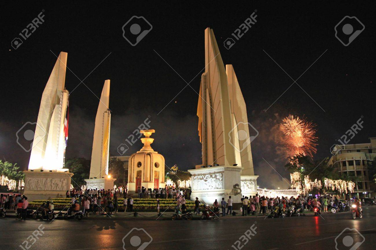 BANGKOK - DEC 5: Fireworks behind the Democracy Monument on Ratchadamnoen Road for the King's Birthday Celebration - Bangkok, Thailand 5th December 2010) Stock Photo - 8449673