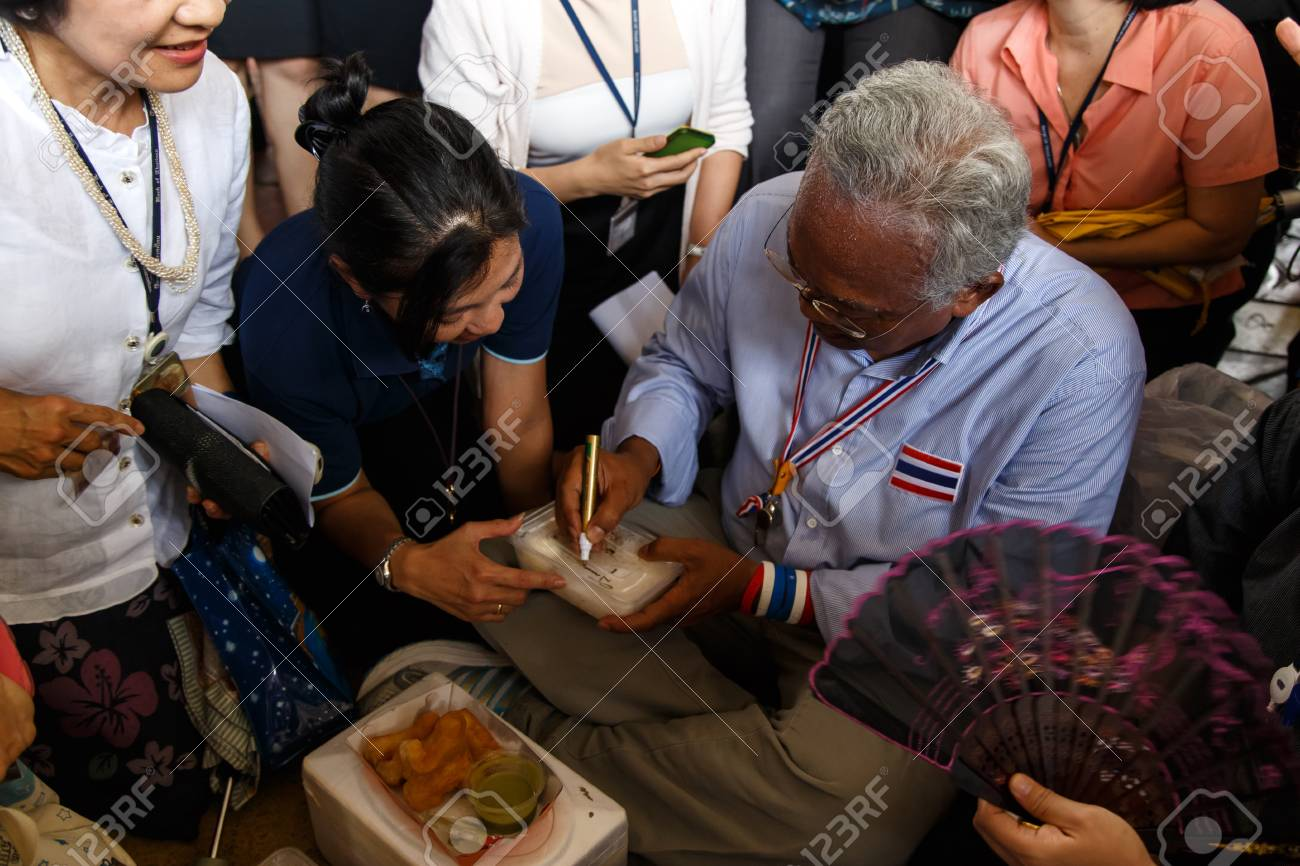 BANGKOK - APRIL 3 2014: Leader Suthep Meets supporters and signs autograph for protesters near Rama 8 Bridge in Bangkok, Thailand Stock Photo - 27171604