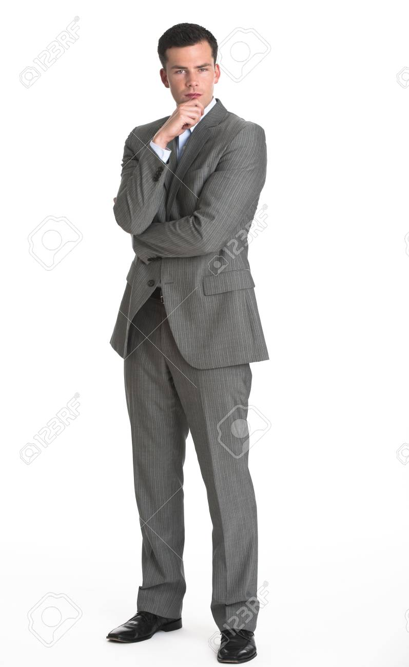 A young man is wearing a business suit and looking at the camera.  Vertically framed shot. Stock Photo - 5371786