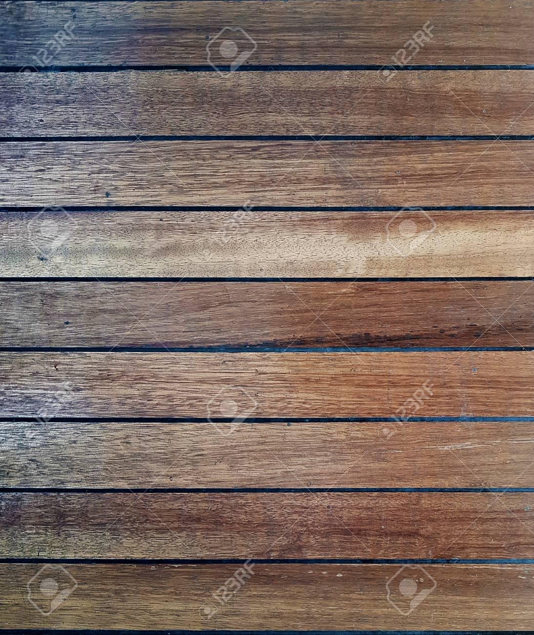 b62b3bcf4 dark slightly worn natural wood parquet tile texture Stock Photo - 82748063