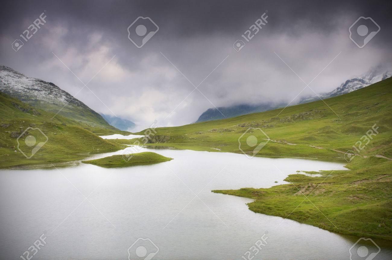 Mountain lake with dark clouds - Montafon, Austria Standard-Bild - 26719145