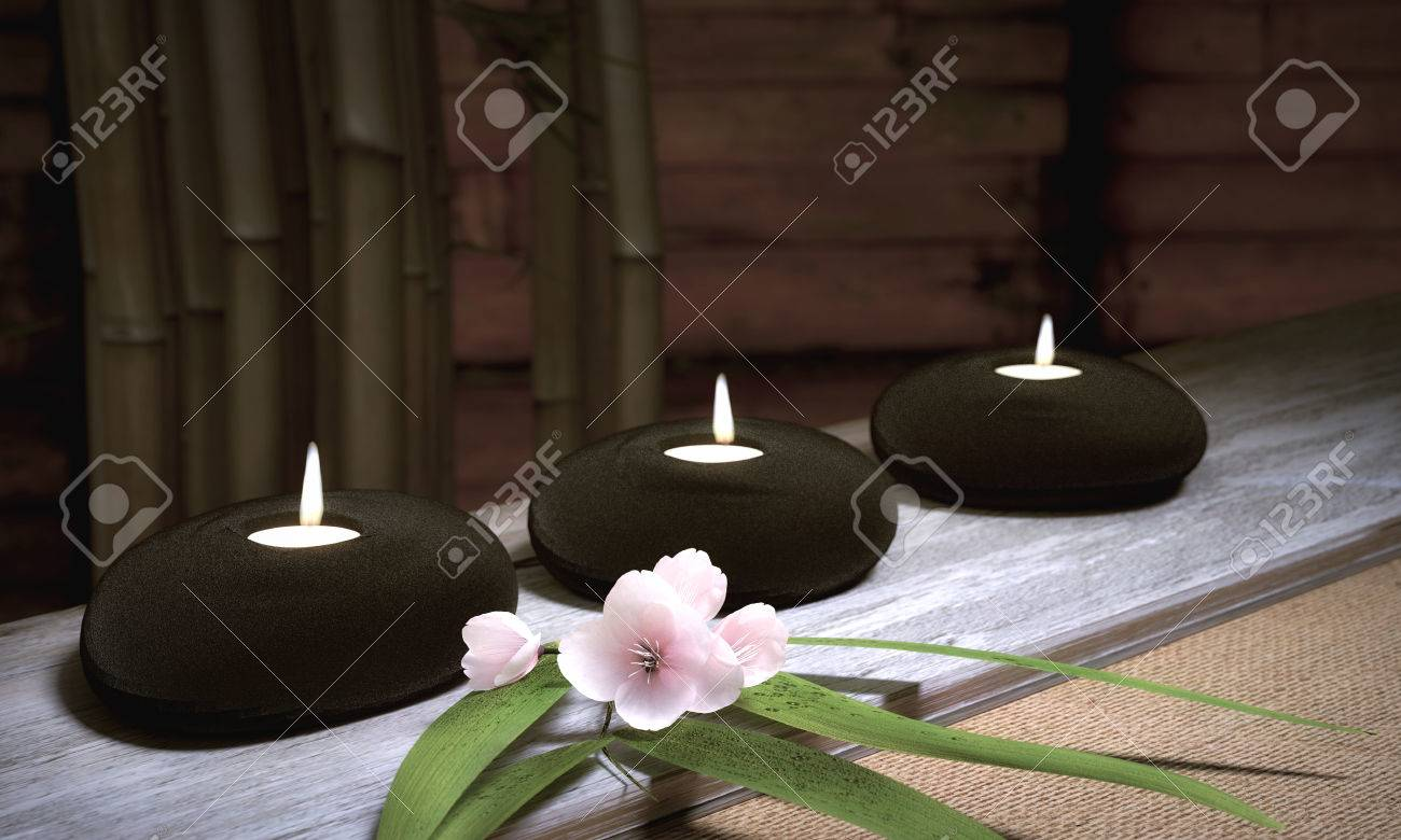 Candles in Stones With Bamboo And Cherry Blossoms Standard-Bild - 28499416