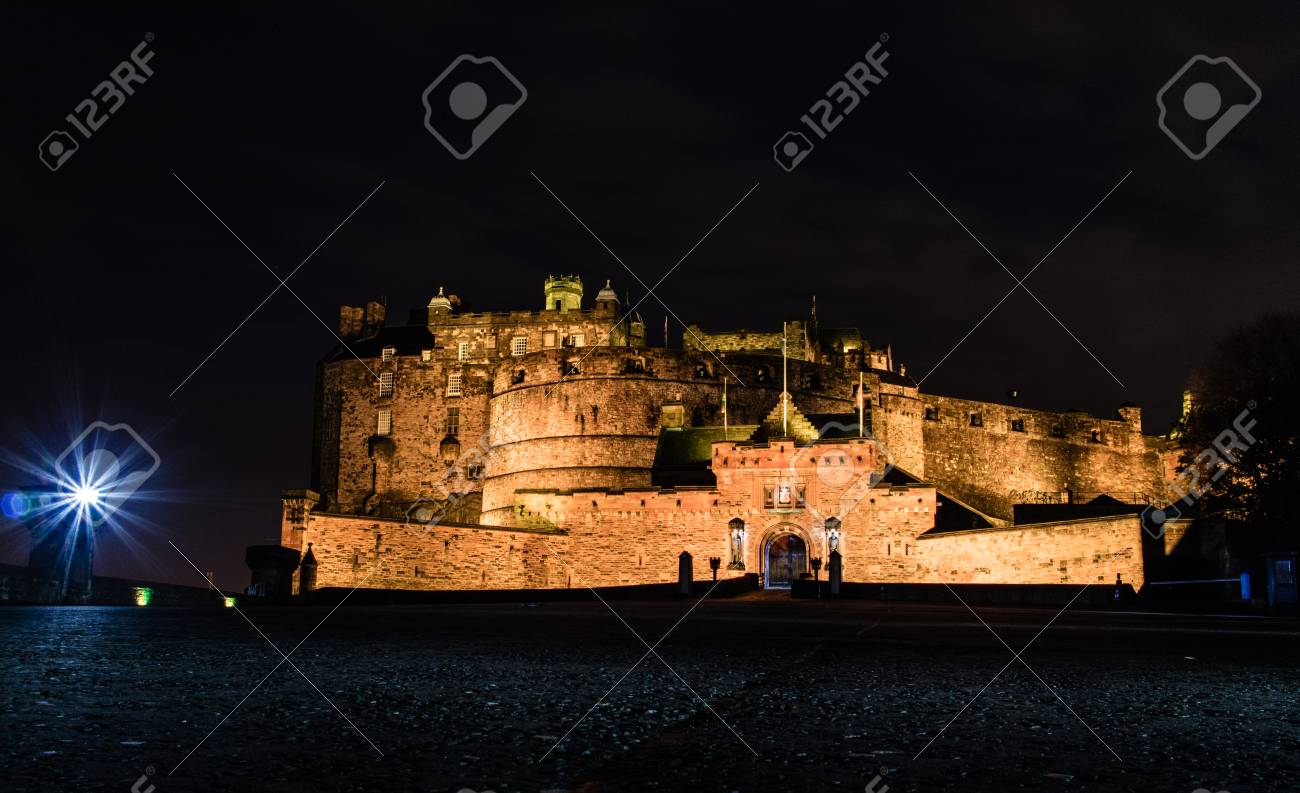 Edinburgh Castle At Night In Winter From The Ground Stock Photo