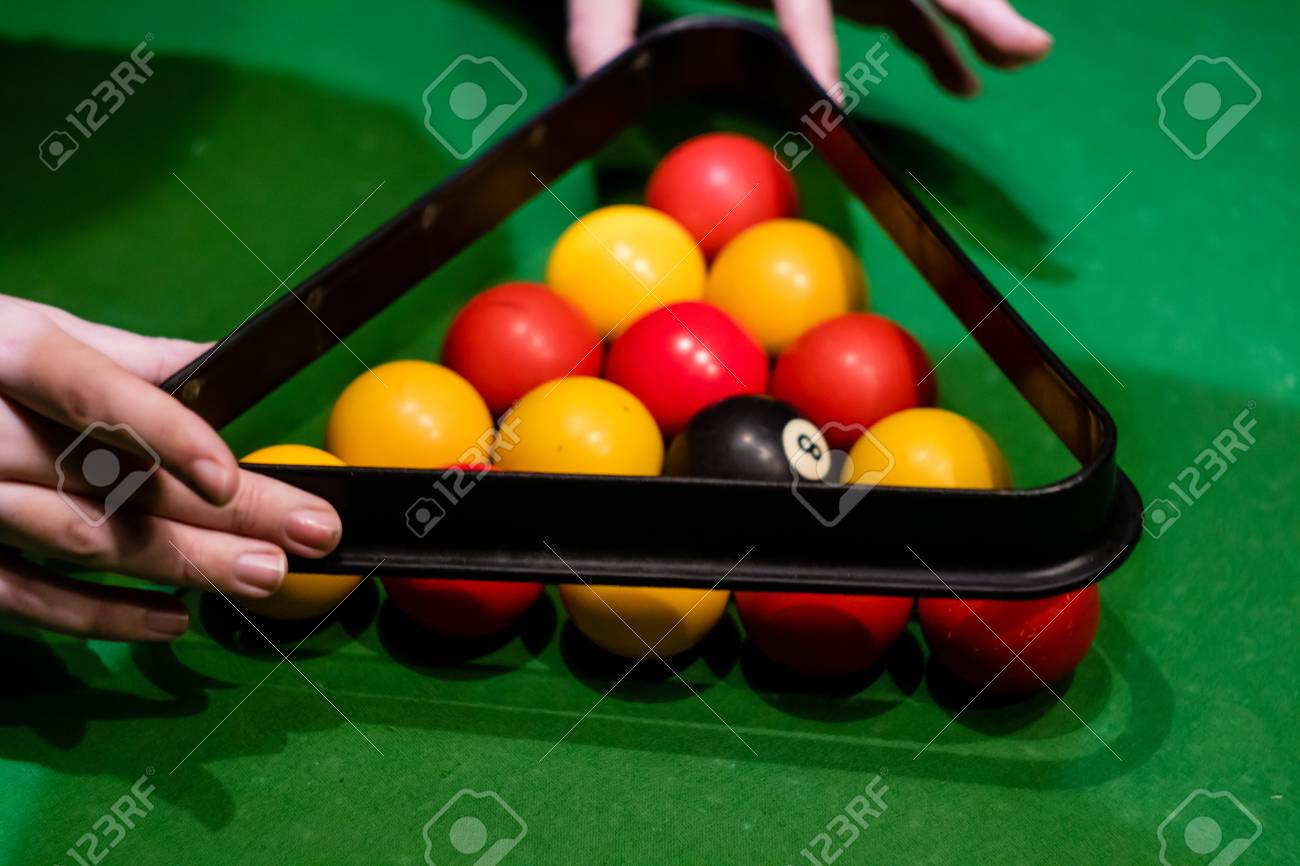 Hands taking away the triangle after setting up the balls in pool Stock Photo - 95105038 & Hands Taking Away The Triangle After Setting Up The Balls In.. Stock ...