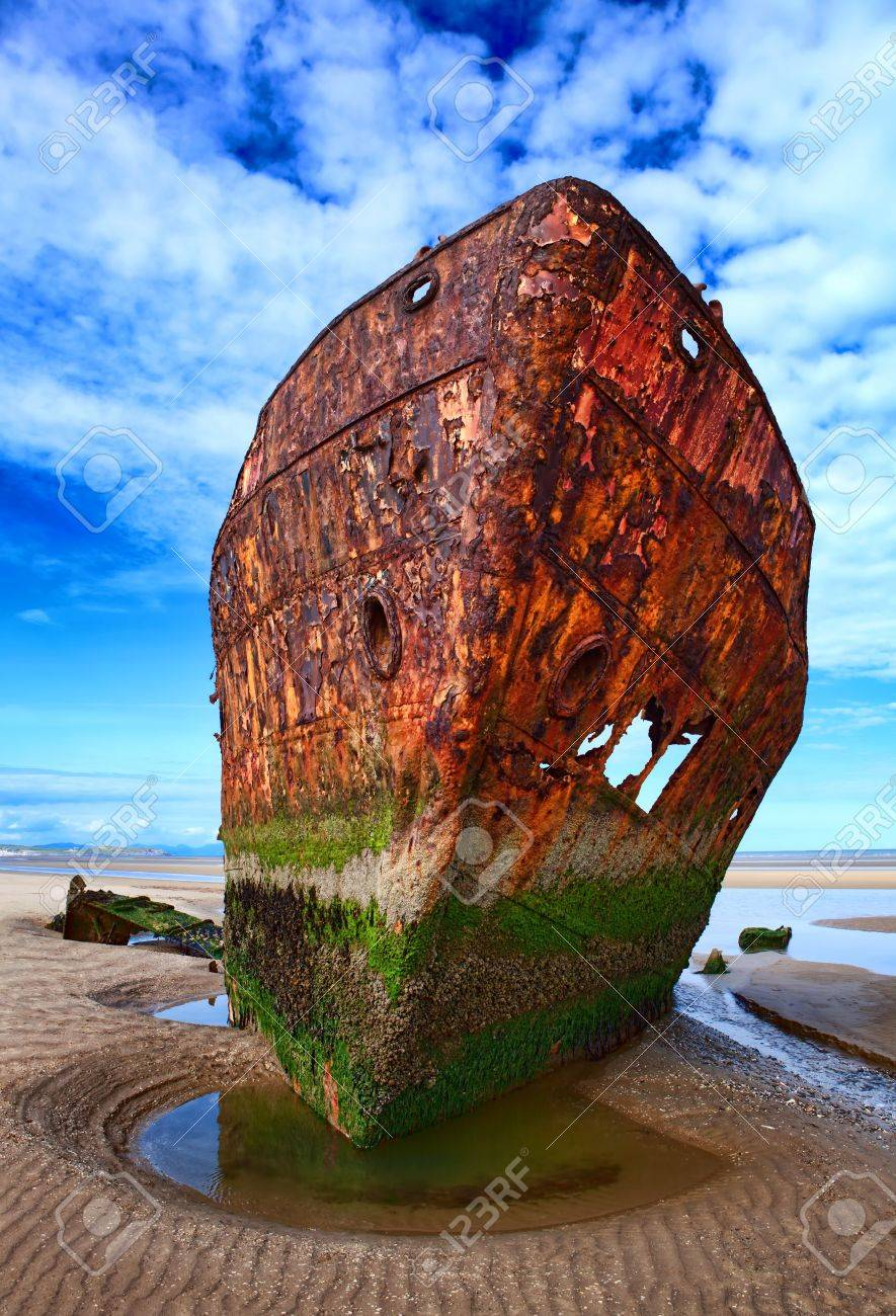 Deserted rusty ship on the coast of a ocean Stock Photo - 13955290