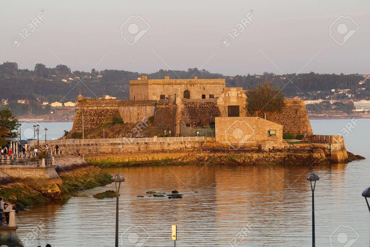 Coruña-Spain. San Anton Castle in La Coruña, in La Coruña at sunset on May 19,2020 - 159560305