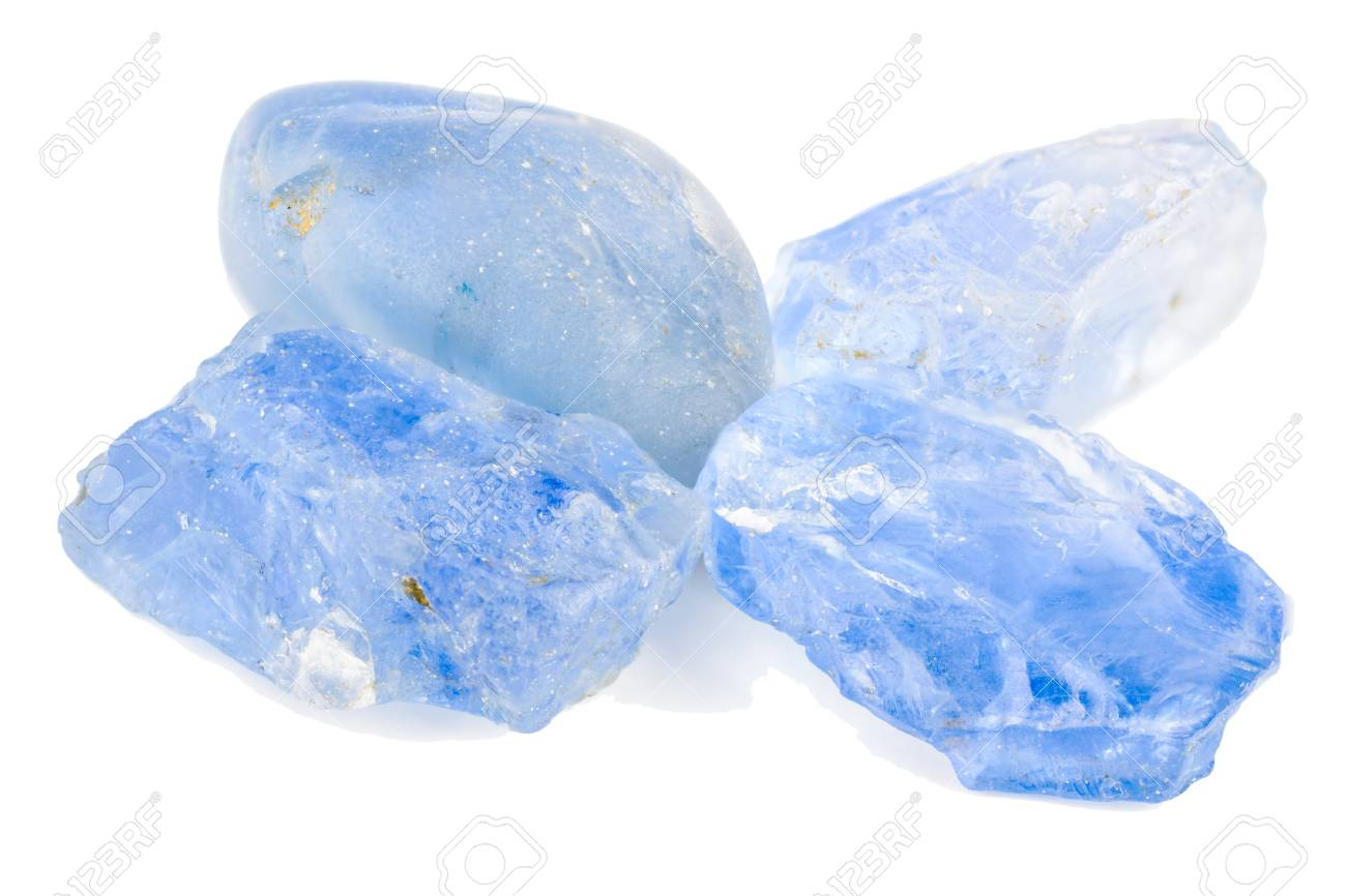 Four blue sapphires in a pile  Raw and uncut Stock Photo - 23840695
