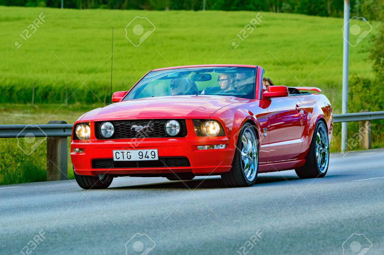 Stock photo ronneby sweden june 26 2015 veteran car street cruise on public roads ford mustang 2005 red