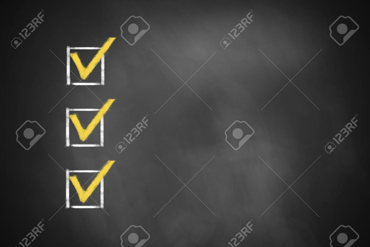three marked checkboxes on a black chalkboard - 30451903