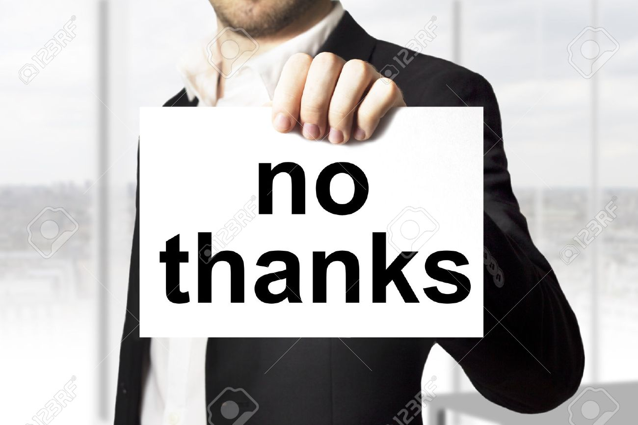businessman in black suit holding sign no thanks - 30533136