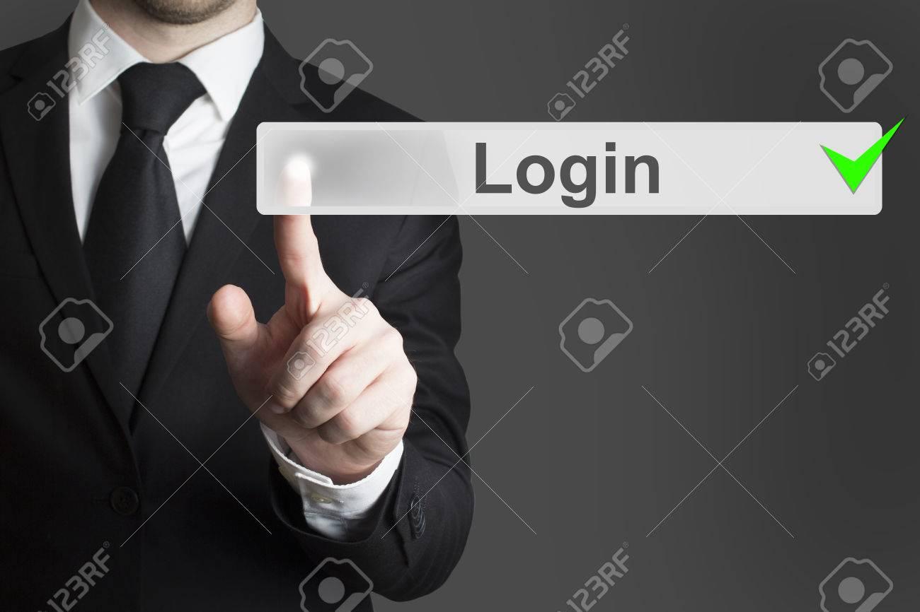 businessman pushing touchscreen button login green checked - 32292828