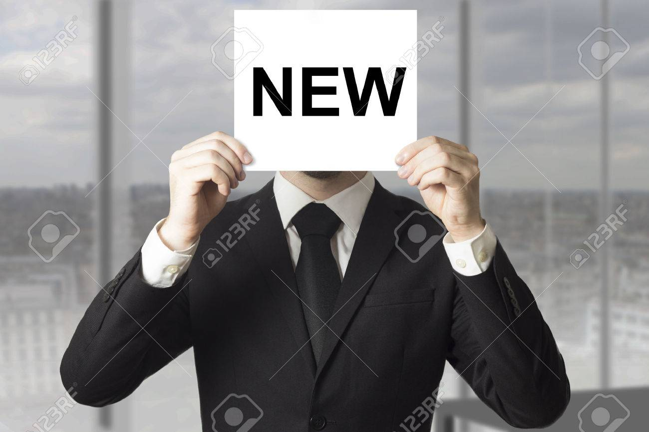 businessman hiding face behind sign new personnel hiring - 32292840
