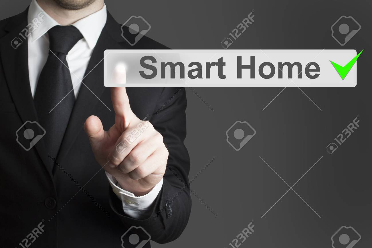 businessman in black suit pushing flat button smart home automation - 32615180