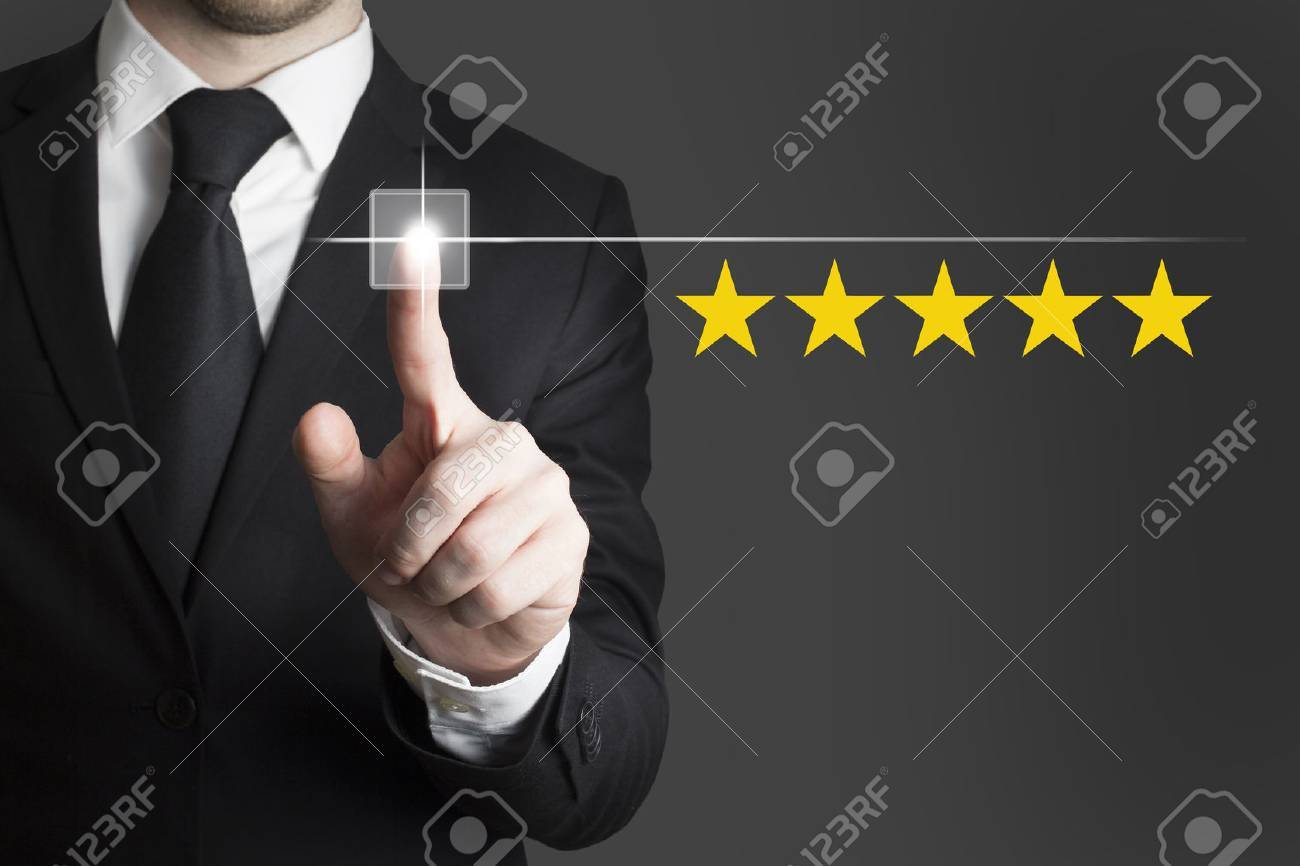 businessman in black suit pushing button five star rating - 34702585