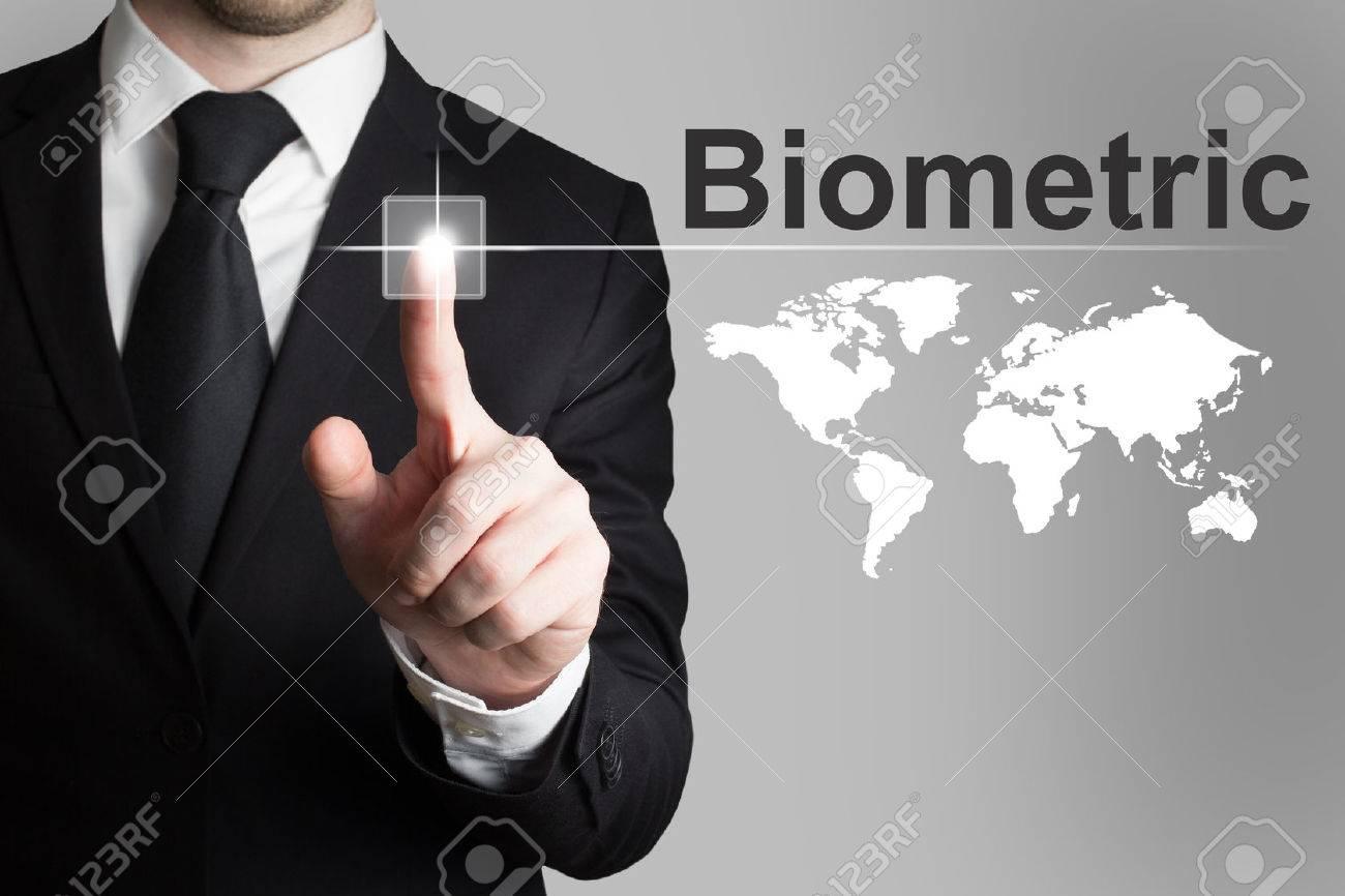 businessman in black suit pushing button biometric worldmap - 35972108