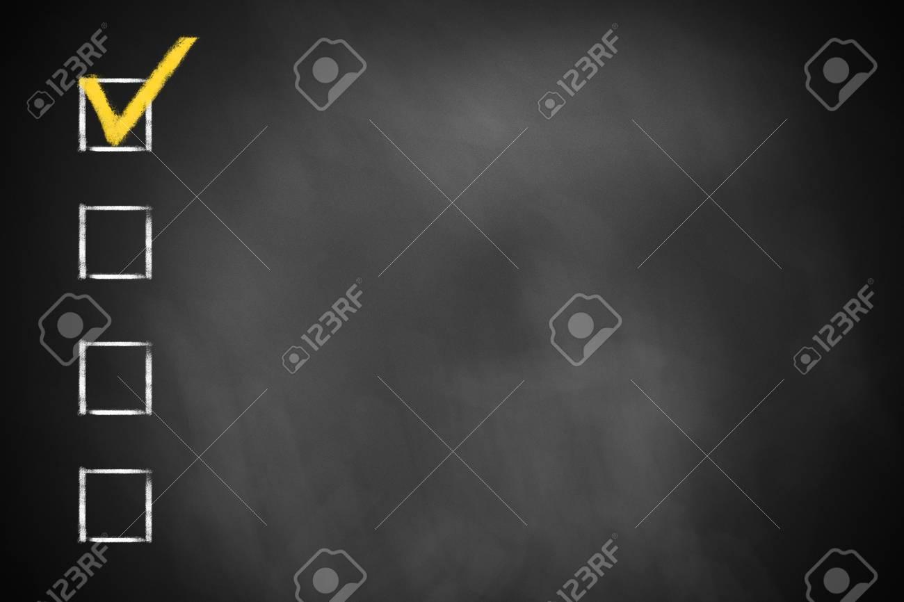 four checkboxes on a dark black chalkboard - 39344072