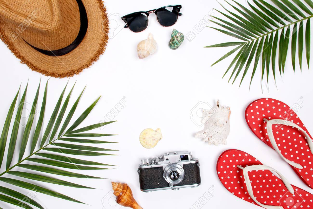 6b6239be Traveler accessories, tropical palm leaf branches on white background with  empty space for text.
