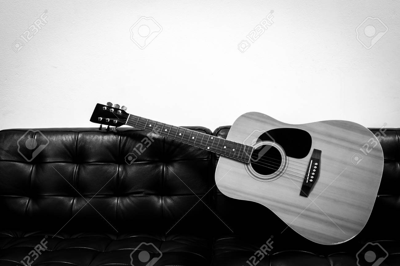 Acoustic Guitar On The Sofa Black And White Color Stock Photo