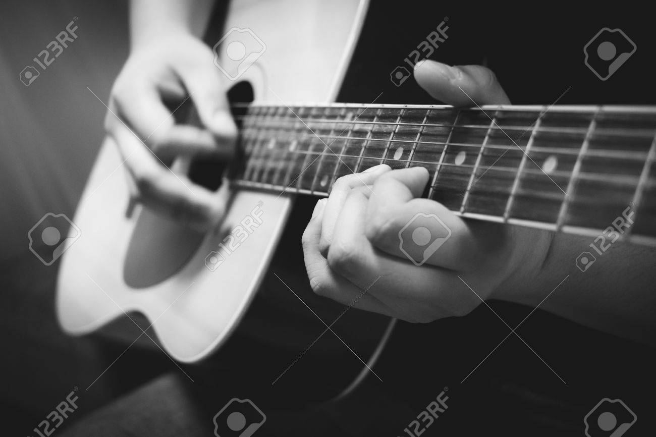 Close Up Hands Playing Acoustic Guitar Black And White Color Stock