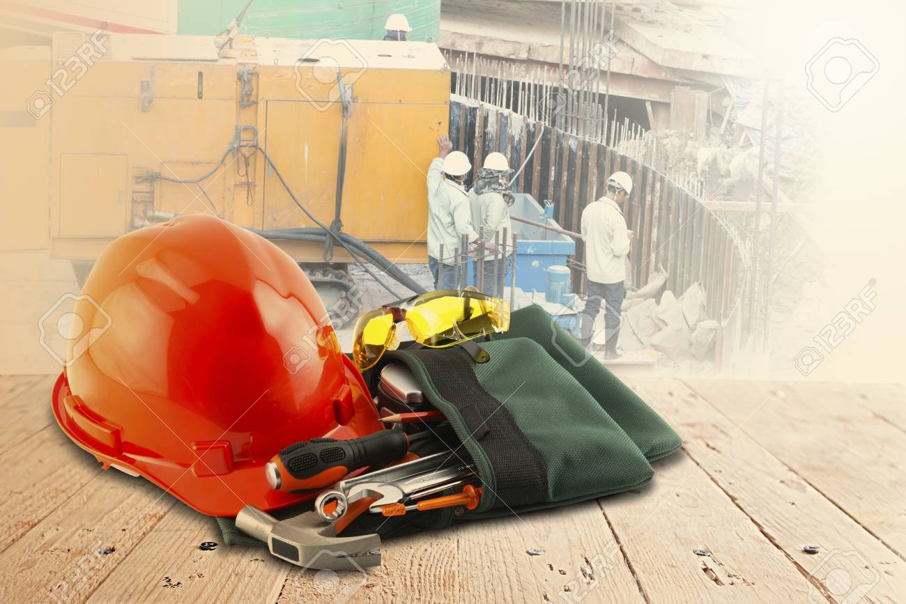 safety helmet and tools on wood table and building construction - 38222071