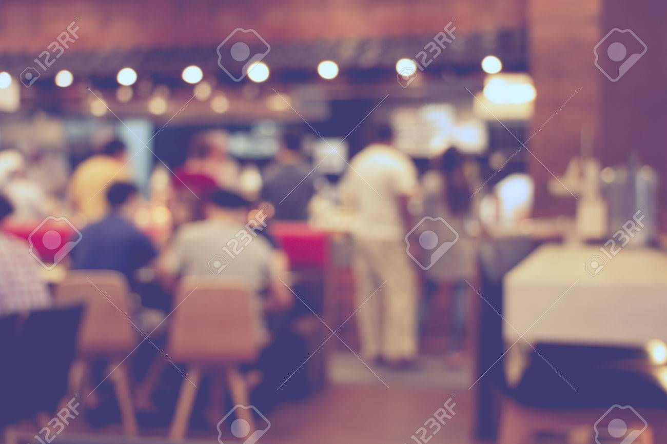 blurred image of shopping mall and people - 38222024