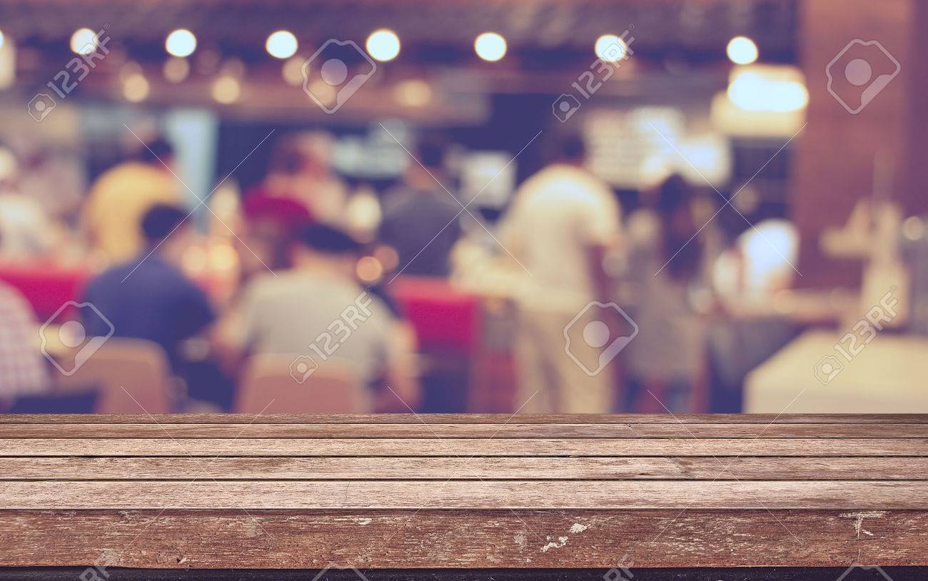 Empty wood table top with restaurant blur with bokeh background,Product display template - 38222003