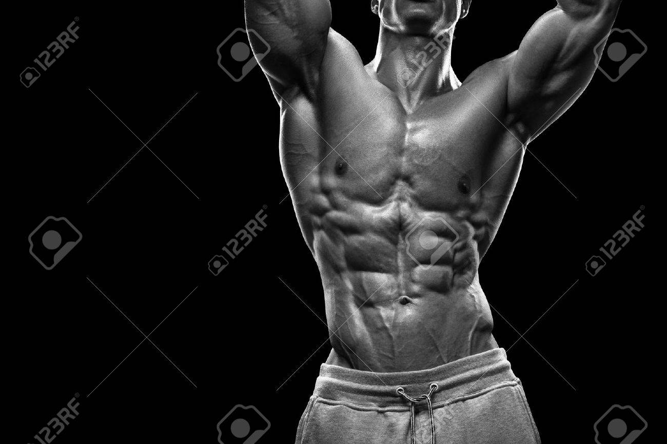 Handsome power athletic young man with great physique. Strong bodybuilder with six pack perfect abs shoulders biceps triceps and chest. Image have clipping path Standard-Bild - 41421931