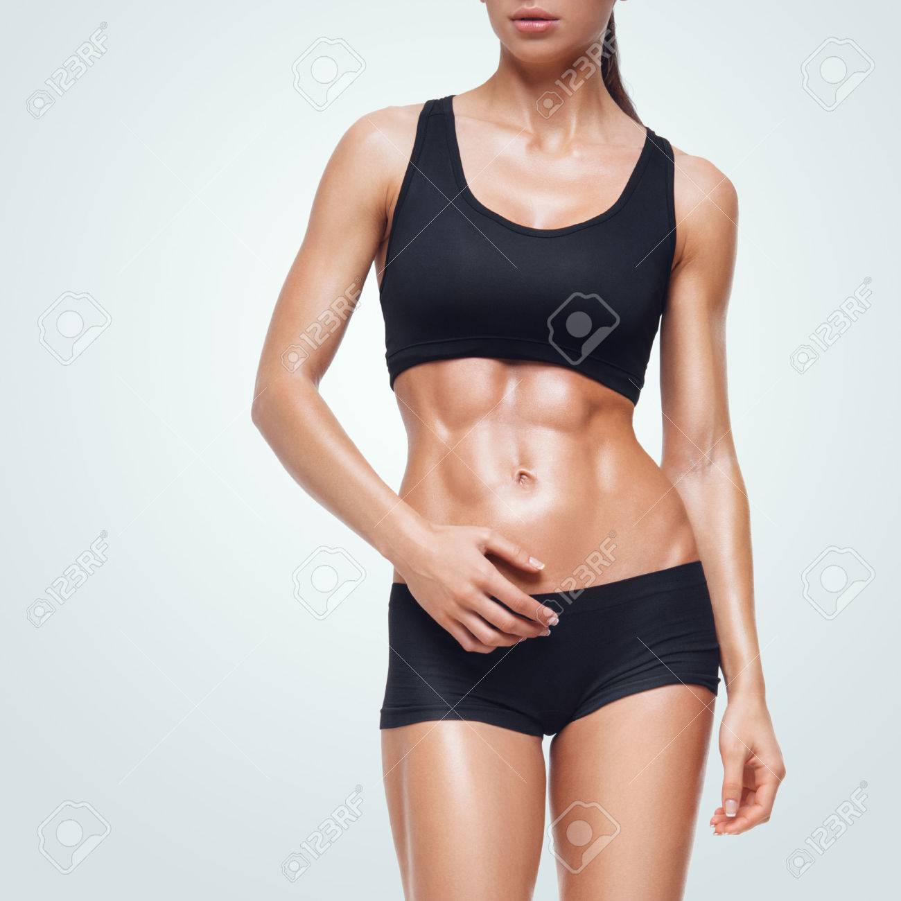 Fitness sporty woman walking. Strong abs showing. Standard-Bild - 41422058