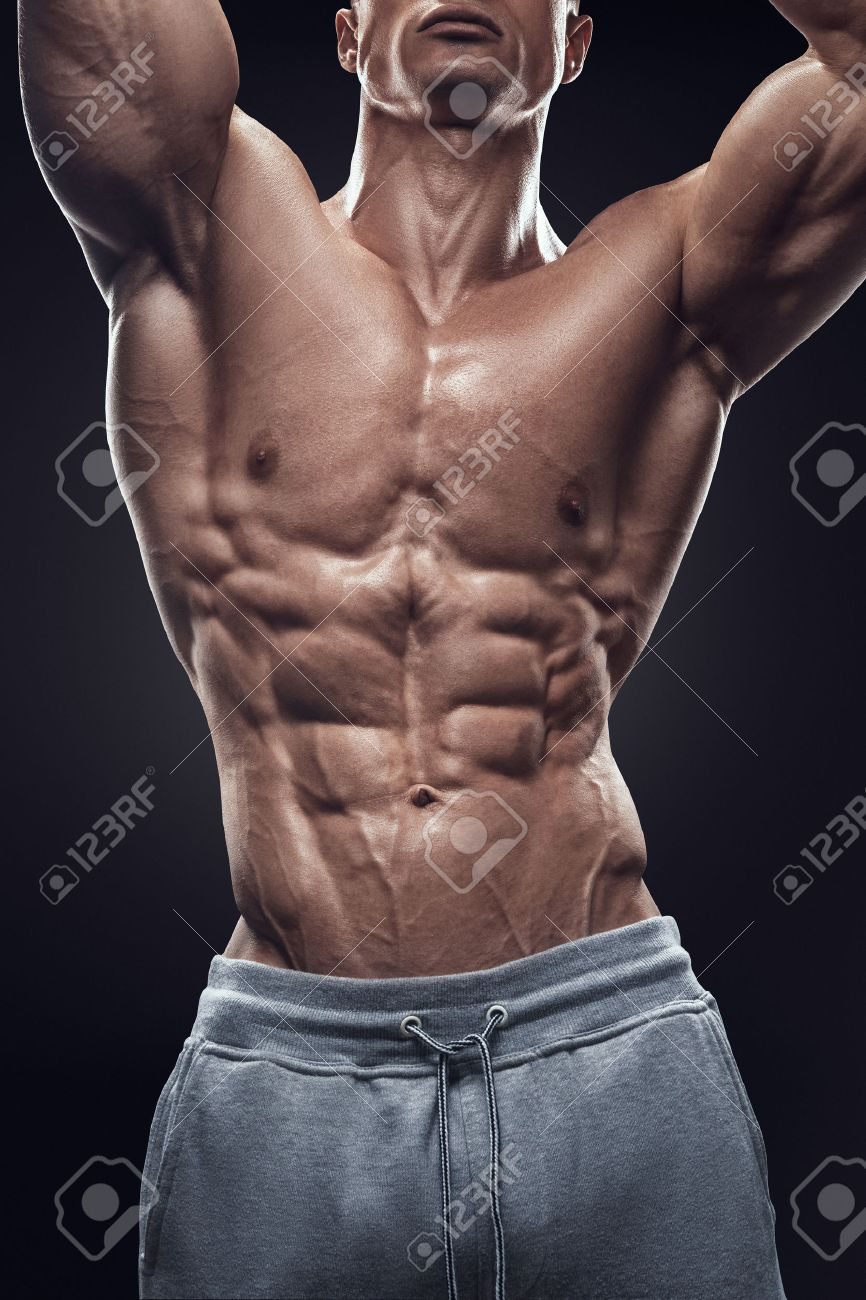 Handsome power athletic young man with great physique. Strong bodybuilder with six pack perfect abs shoulders biceps triceps and chest. Image have clipping path Standard-Bild - 41423193