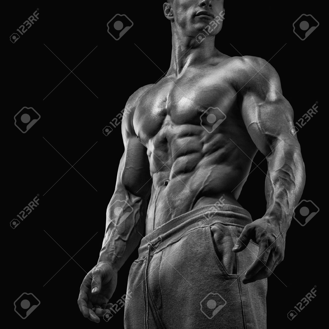 Strong and handsome young man with muscles and biceps. Close-up of a power fitness man. Black and white photo Stock Photo - 44585827