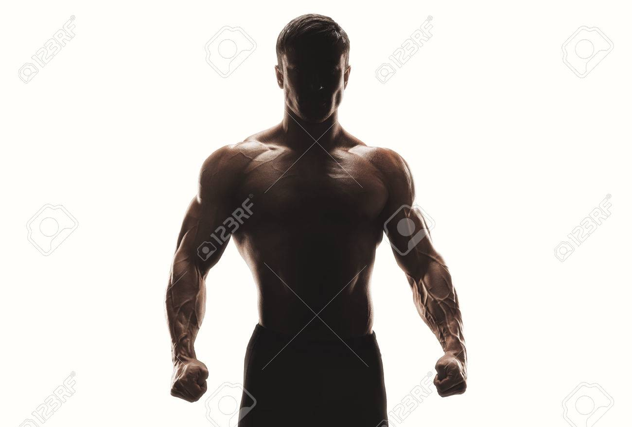 Dark silhouette of a strong man on white background. Confident young fitness man with strong hands and clenched fists. Clipping path inside Standard-Bild - 67305799