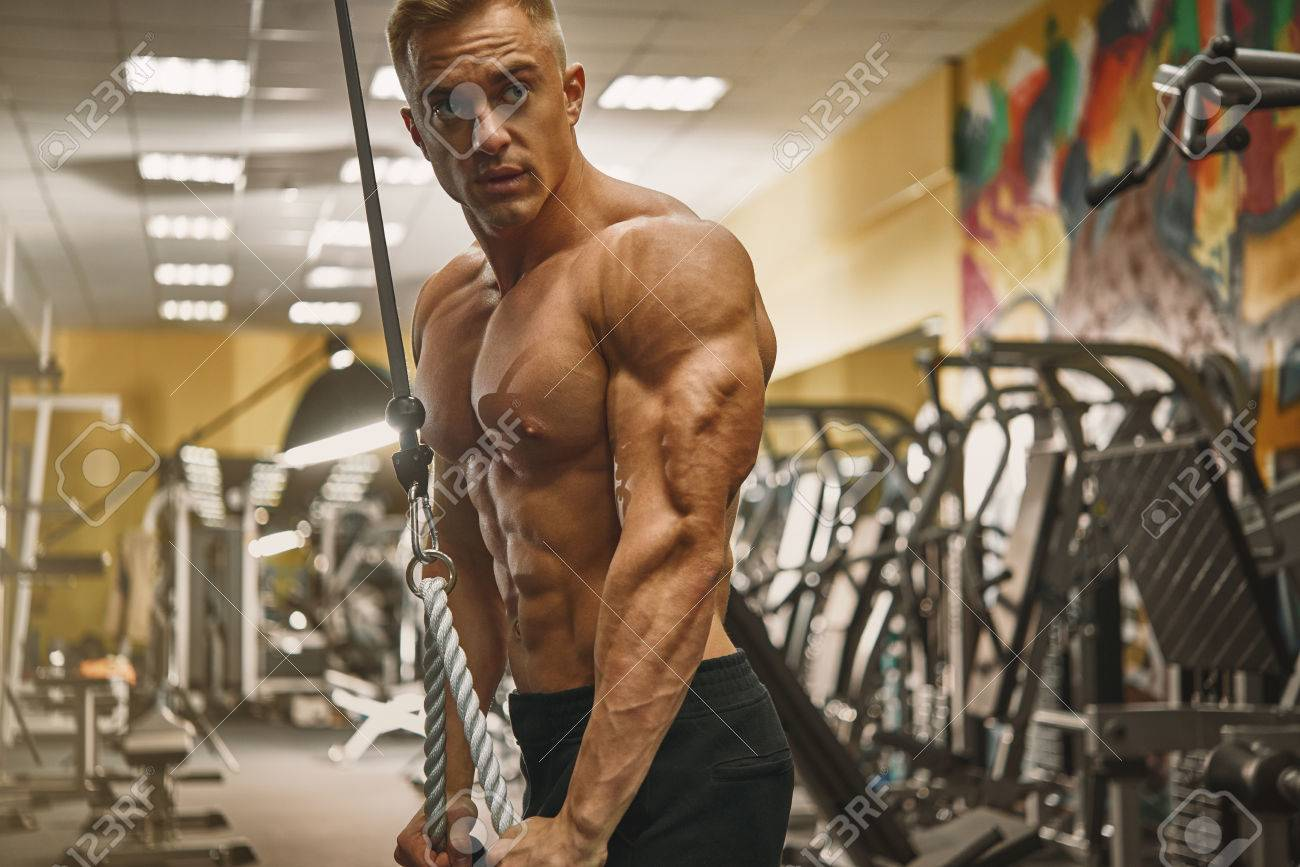 Confident Handsome Athletic Bodybuilder Workout Triceps Pushdown Rope Attachment Shirtless Power Sportsmen Perfect Physique Vein Core