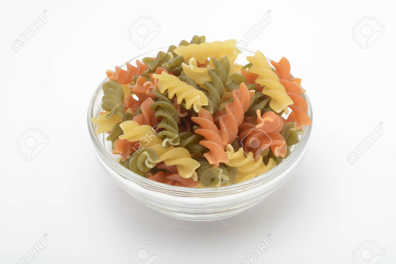 Tricolor spiral pasta, raw food - 126447151